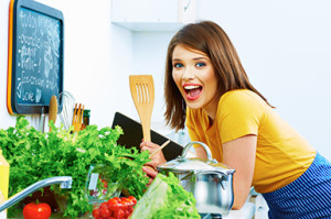 Woman cooking with fun. Kitchen.